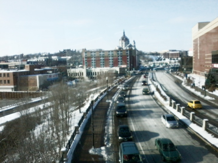 An edited cell phone snapshot of Kellogg Boulevard shot from the skyway into the Xcel Energy Center.