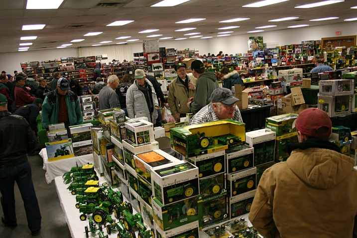 Masses of shoppers among a mass of merchandise.
