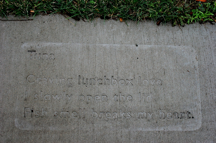 A poem by Mankato resident Yvonne Cariveau imprinted  in the sidewalk at Riverfront Park, Mankato, as part of the WordWalk project.