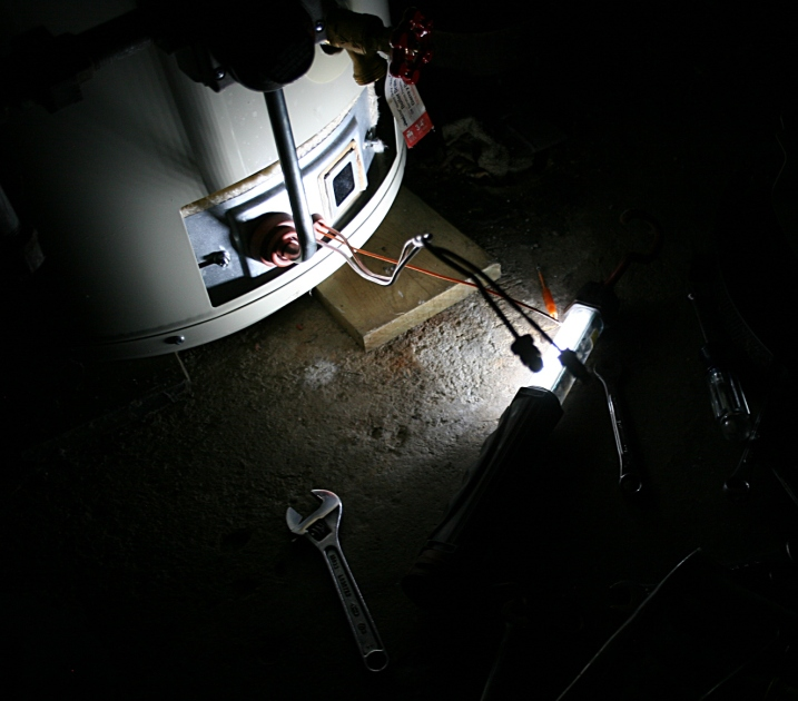 Tools and light are in place to replace the thermo couple control on the water heater.