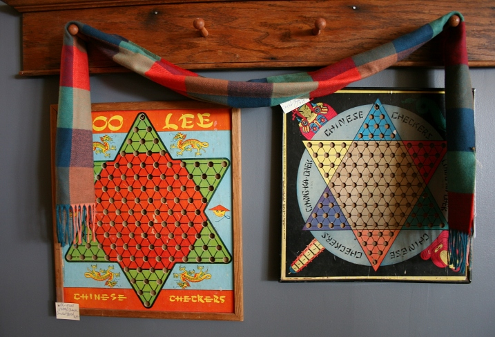I own a vintage Chinese checkers board similar to these, found at a garage sale 30 years ago.