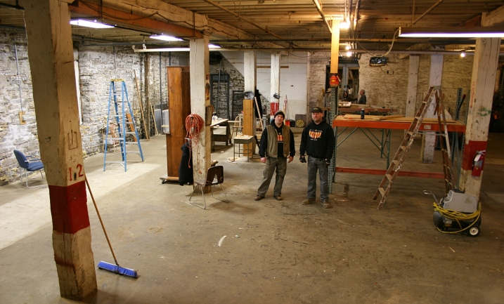 Chris Voegele, left, and Noah Strouth inside the space that will house Patriot's Brewing brewery.