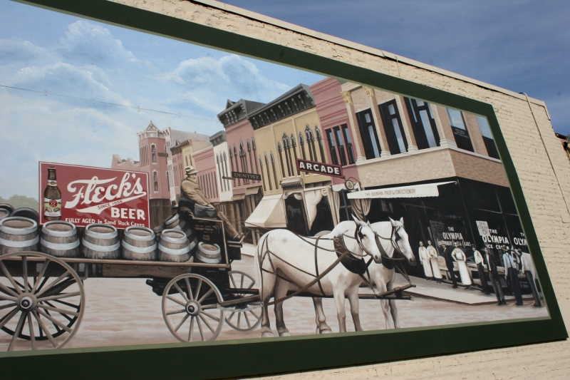 A downtown Faribault mural featuring Fleck's beer.