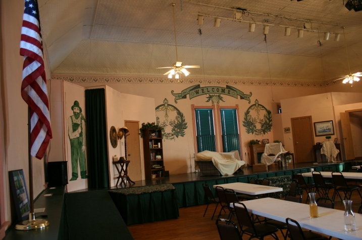 """A view of the set for """"On Golden Pond"""" with Big Honza painted on the wall to the left."""
