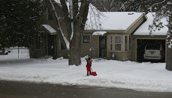 My little neighbor boy shoveling the driveway in February 2013.