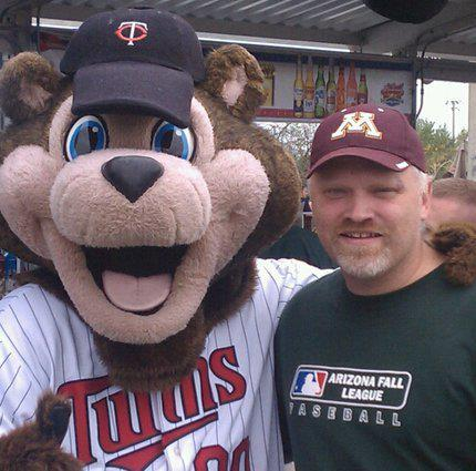Terry Borning with TC Bear, the Twins mascot.