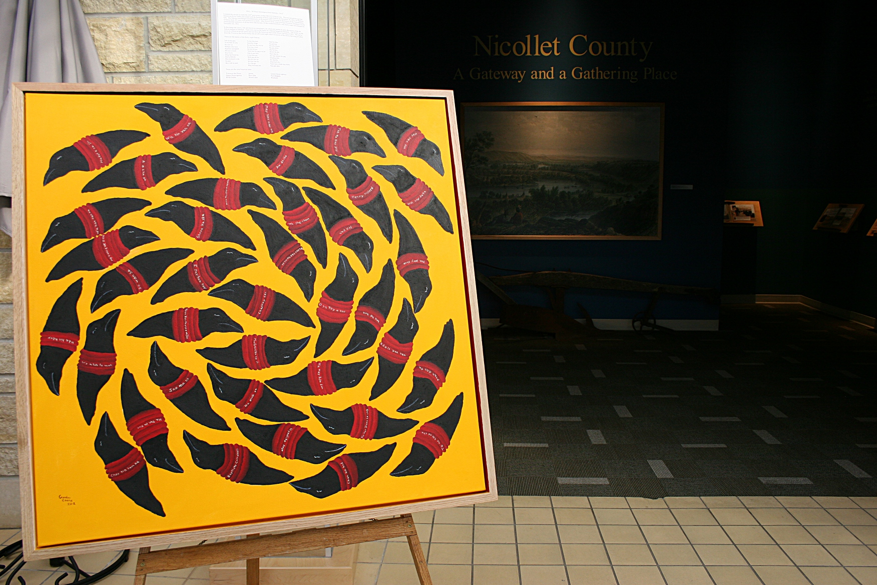 """This artwork by Gordon M. Coons, which was on recent temporary display at the Traverse des Sioux Treaty Center, marks the 150th anniversary of the U.S.-Dakota War of 1862. According to information posted with the piece, """"...the crows, known as messengers, are silent and unable to carry the stories of the 38 Dakota hanged in Mankato. Each crow carries the name of a Dakota hanged in Mankato. The texture on the crows is a blend of acrylic paint and soil from the historical sites of the Sioux Uprising of 1862. The soil is from the Traverse des Sioux treaty site of 1851 and eight other locations of the Sioux Uprising of 1862."""""""
