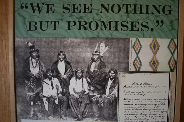 A photo panel at the Traverse des Sioux Treaty Center in St. Peter shows Dakota leaders photographed in Washington D.C. in 1858. The photo is from the Minnesota Historical Society.