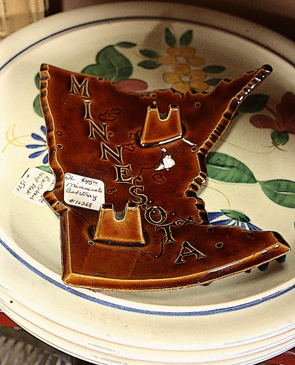 One of our more unique finds, a souvenir Minnesota-shaped ashtray.