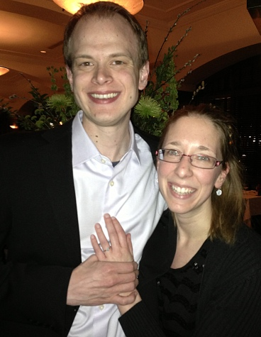 "Marc and Amber, newly-engaged and celebrating at the St. Paul Grill. Marc ordered a steak, saying, ""That is what a man does after he asks a woman to marry him."""