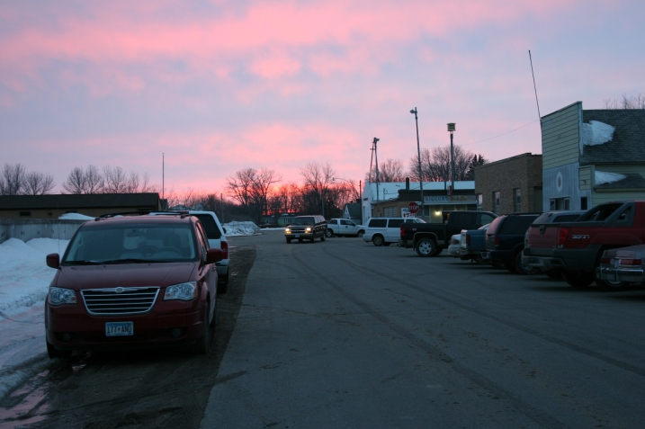 Standing in front of the community hall, I watch the sun set in my hometown.