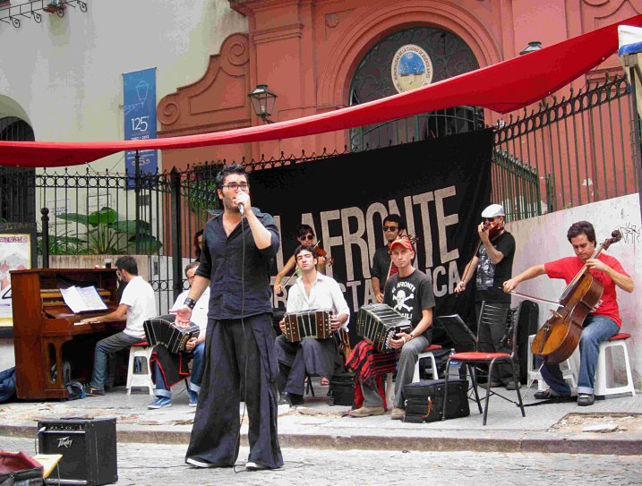 A tango band performs on the street during a fair in San Telmo barrio of Buenos Aires.
