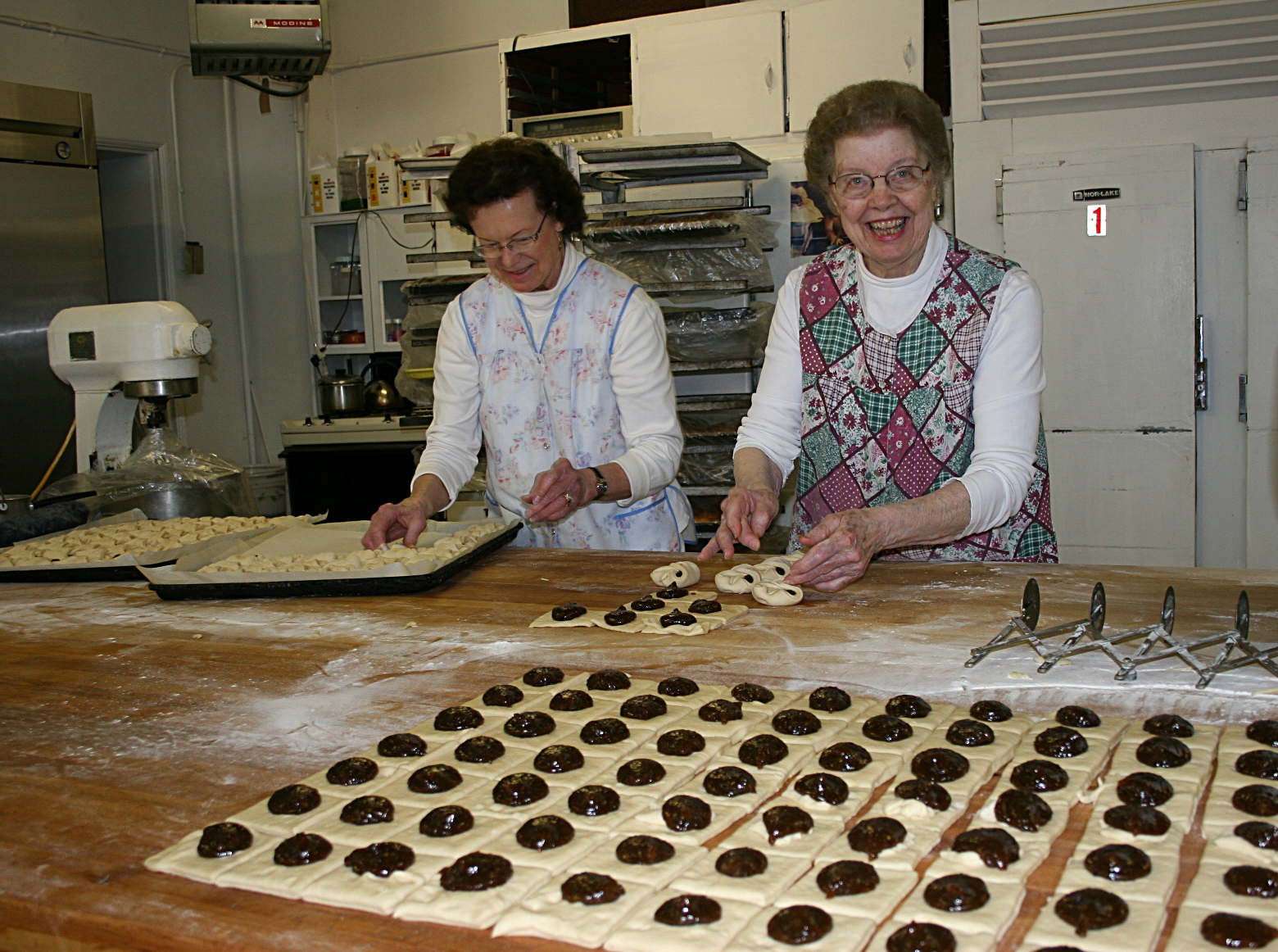 Mary Ann Kaisersatt, left, and Jule Franke make prune-filled kolacky.
