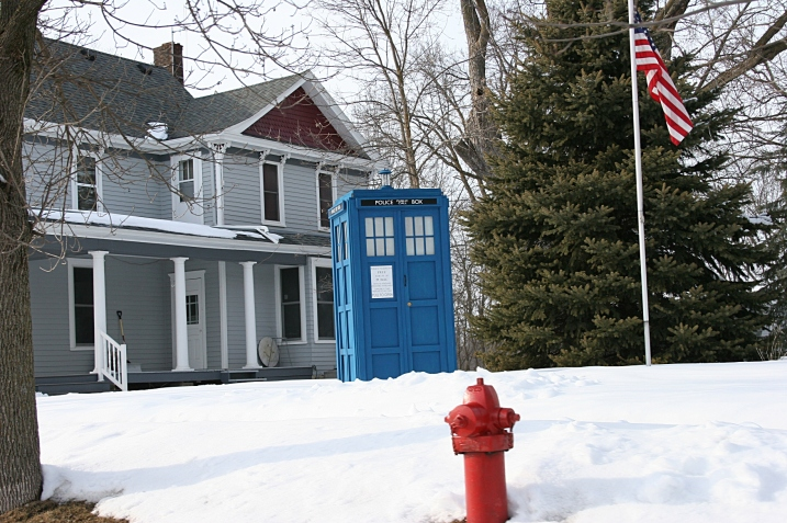 The TARDIS is labeled as a Police Public Call Box. A note on the front reads: Advice and Assistance obtainable immediately. Officers and cars respond to all calls. Pull to open.