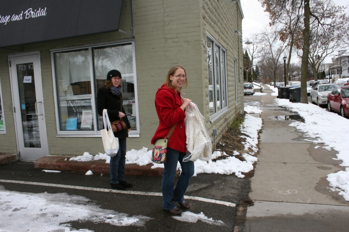 """My daughters leave Andrea's Vintage Bridal after Amber, right, finds her """"perfect"""" wedding dress."""