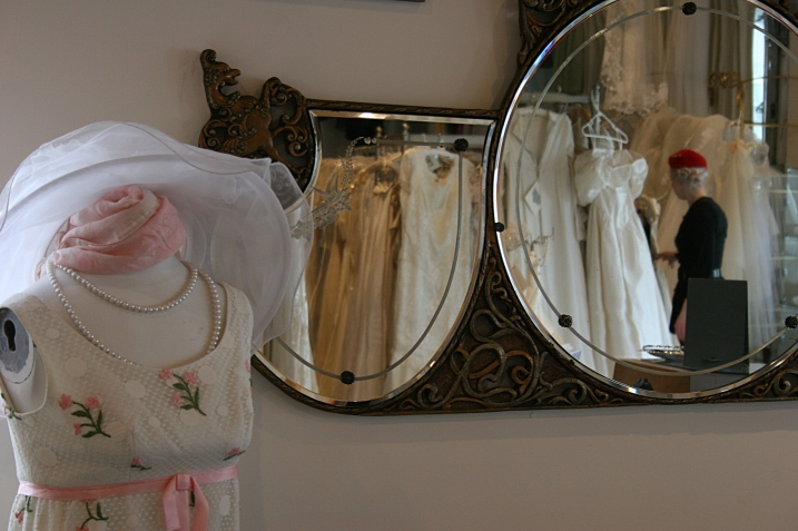 A sweet vintage dress, left, and Nikolina reflected in shop mirrors.