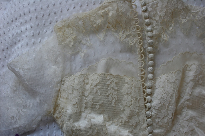 Just like the back of my aunt's dress, my mom's bridal gown closes with a long row of buttons.
