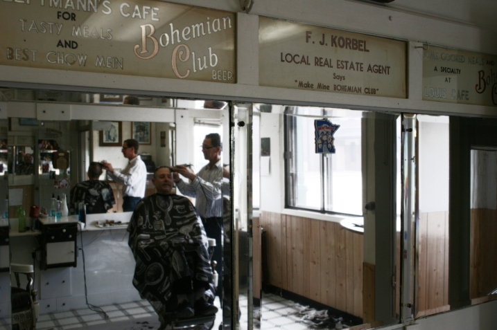Above the bank of mirrors on the north side are vintage signs printed at Bohemian Club Beer.