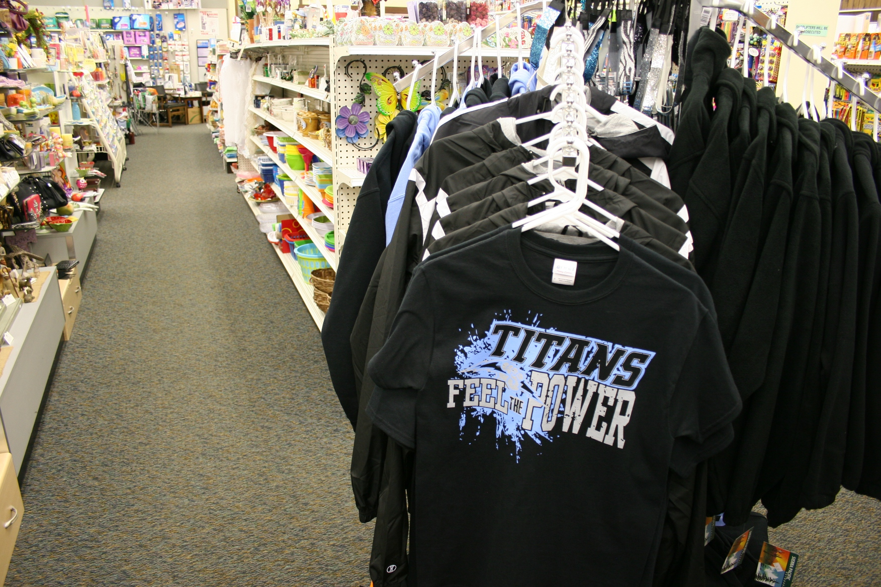 The drugstore sells Titans apparel for the local school.