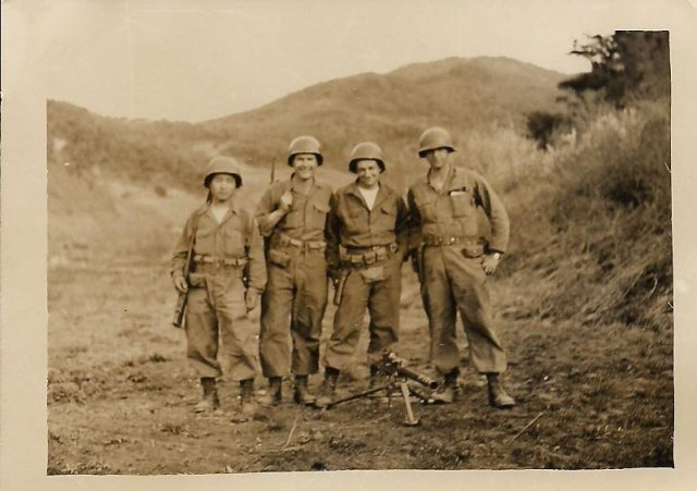 "This photo from my dad's collection is tagged as ""Kim, Rowe, Allen & me, May 1953 Machine Gun Crew."" That's my father on the right."