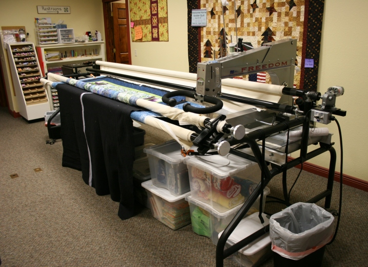 Michelle uses this long-arm sewing machine to quilt at the shop. Quilters can also pay to use the machine.