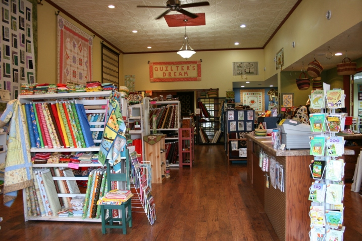 Quilter's Dream features a beautiful original tin ceiling and a wonderful collection of quilts, fabrics, notions and more.