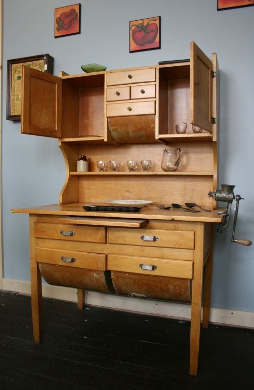This 100-plus-year-old Hoosier cabinet had seven layers of paint on it before Mary Bowen refinished it. The cabinet is being sold in her son Dean Turnlund's store for $325.