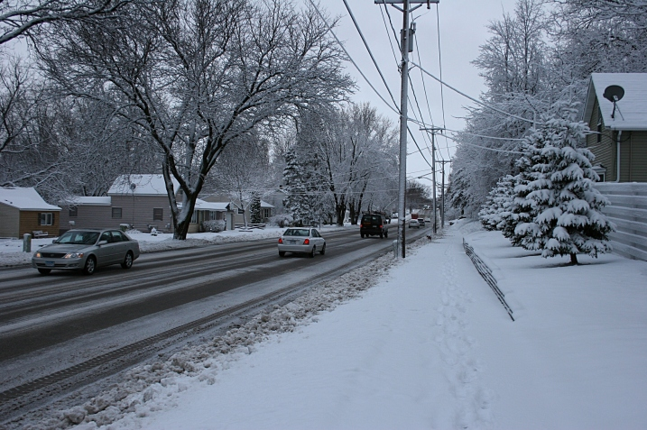 A portion of the  unshoveled sidewalk by my house, which I cleared of snow this morning.