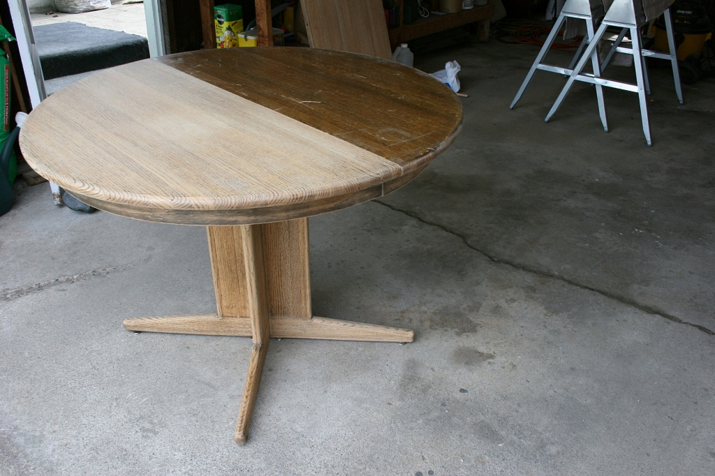 Compare the two table halves, the left side stripped and sanded, the right side top, not.