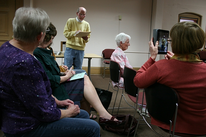 "Audience members read their poetry prior to Boss' reading. Some audience members, like me, were honored at a ""Meet and Greet the Poets"" reception earlier for those published in Poetic Strokes 2013, a regional anthology of poetry published by Southeastern Libraries Cooperating."