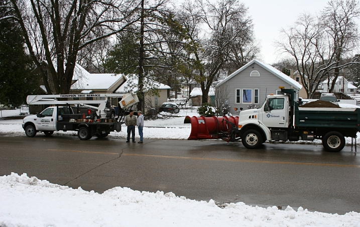 A City of Faribault snowplow driver and a Thompson Tree Service worker confer along Willow Street this morning.