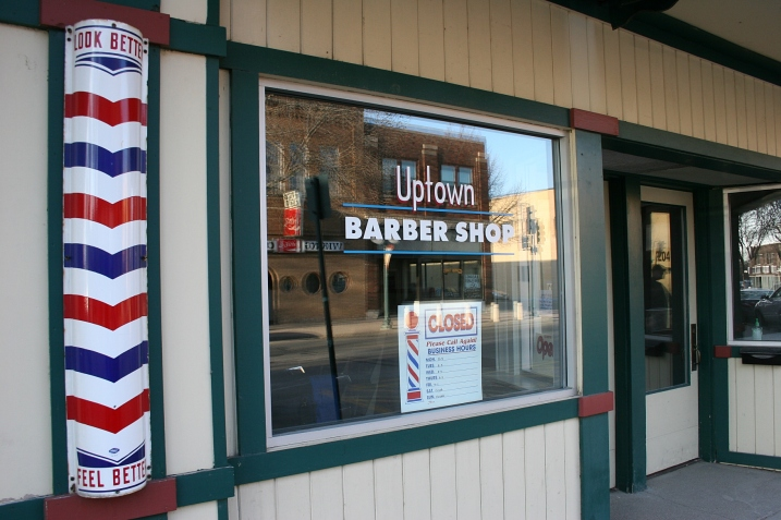 A downtown barbershop complete with a barber's pole charms visitors like me.