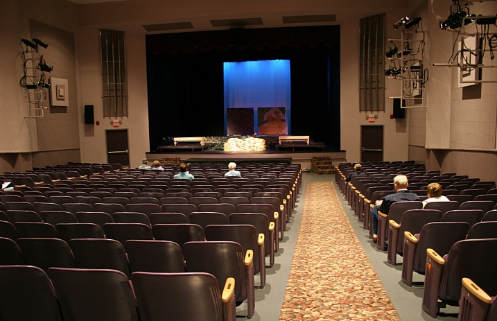 Audience members filter into an historic theatre for a play presented at a Center for the Arts.