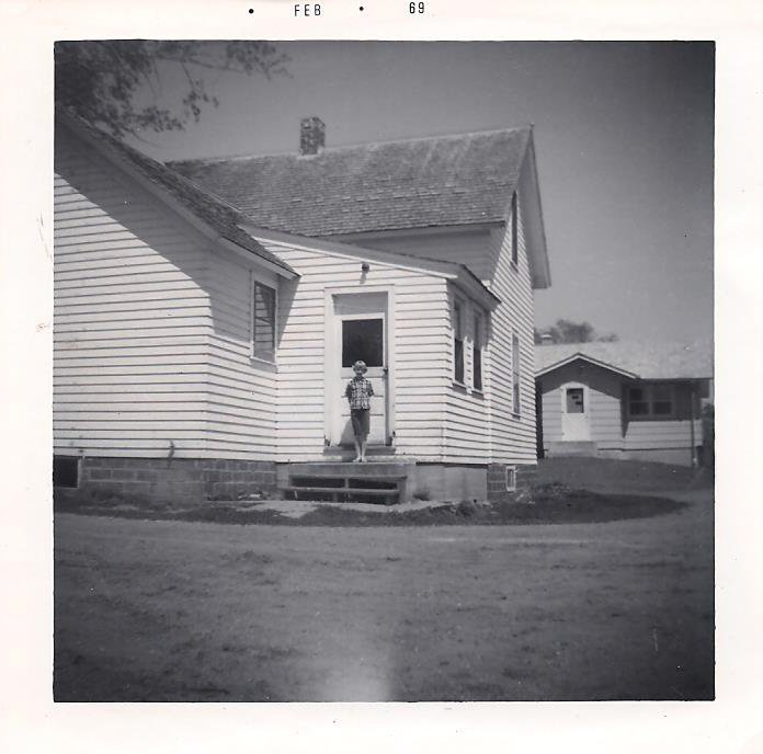 """The old farmhouse to the left, where I grew up with the """"new house,"""" built in the late 1960s."""
