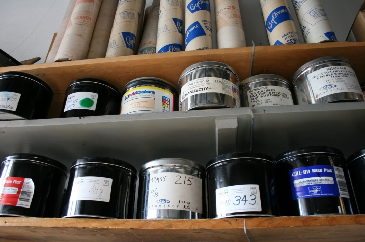 Cans of ink line shelves.