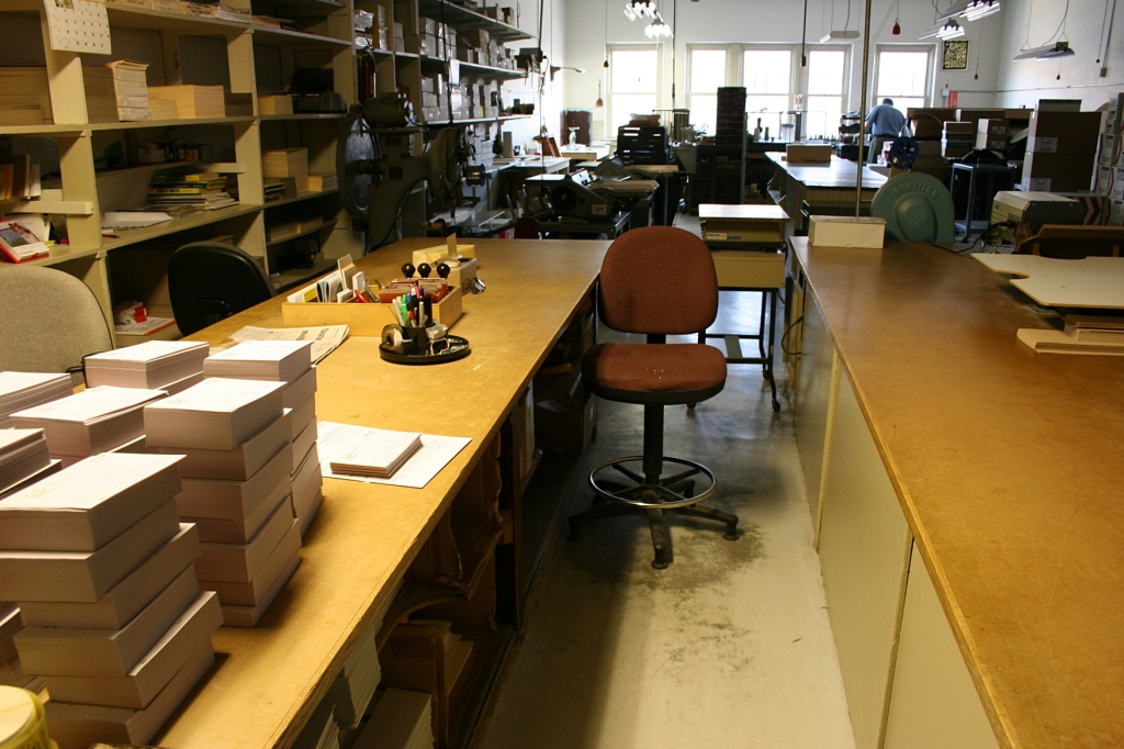 A portion of the print shop looking toward the bank of street-side windows.