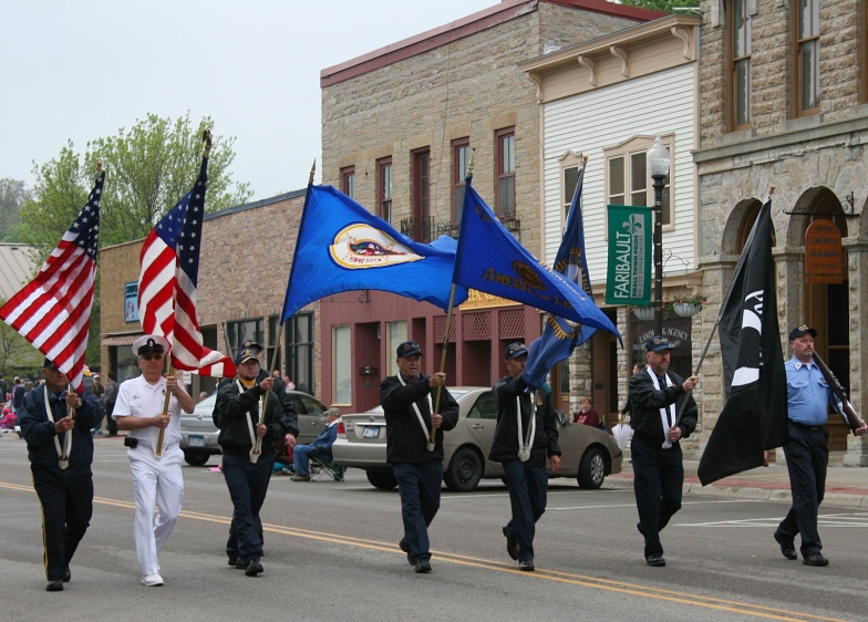 The Color Guard leads the 2013 Memorial Day parade in Faribault, Minnesota.