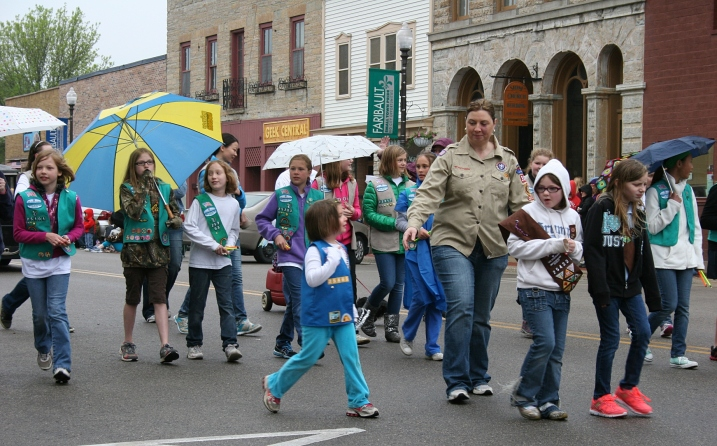 Girl Scouts walk in the rain at the end of the parade.