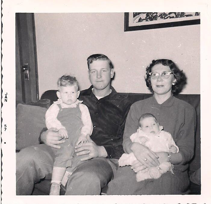 My parents with my brother and me in a photo dated January 1957, but likely taken a few months earlier.