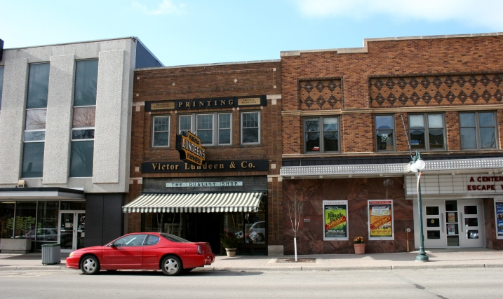 A street level view of Victor Lundeen Company, left, and the Fergus Theatre on the right.