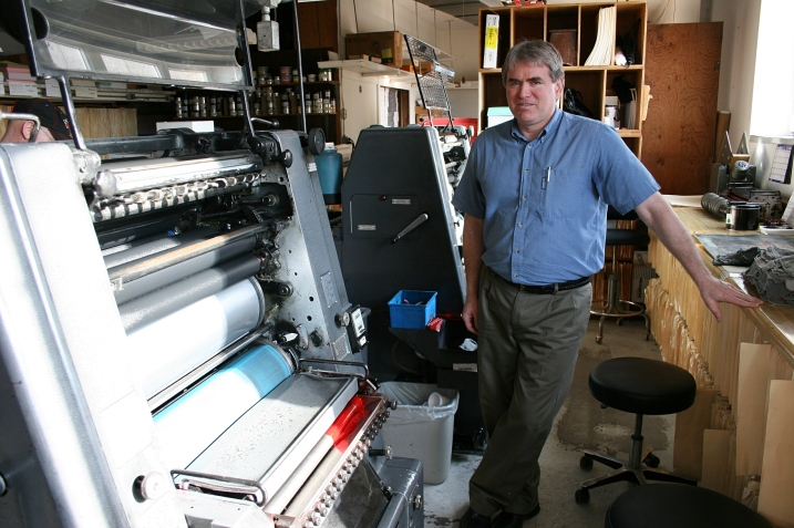 Tour guide Paul Lundeen inside his print shop.