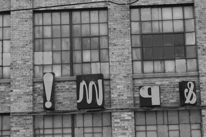 Signage on the exterior of the Hamilton Wood Type Museum.