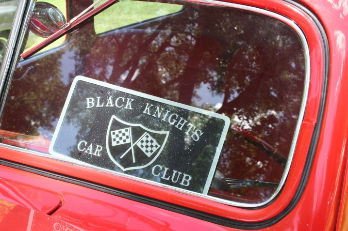 A car club advertised in a windshield.