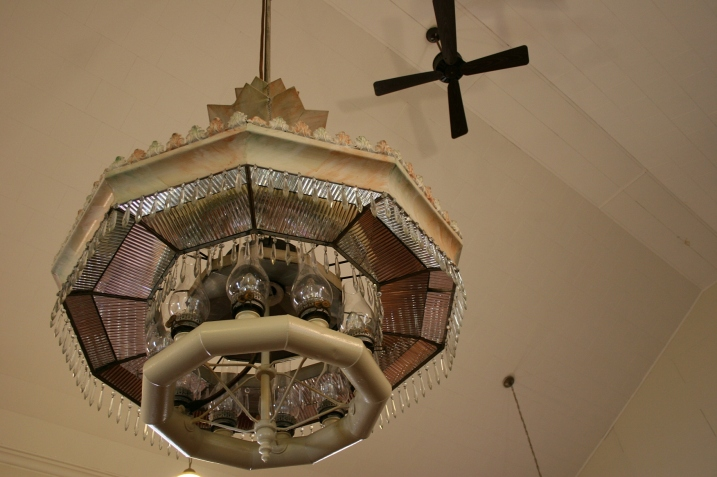 Suspended from the ceiling is this incredible historic light fixture.