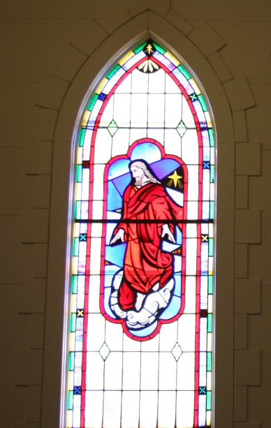 Stunning stained glass windows grace the sanctuary.