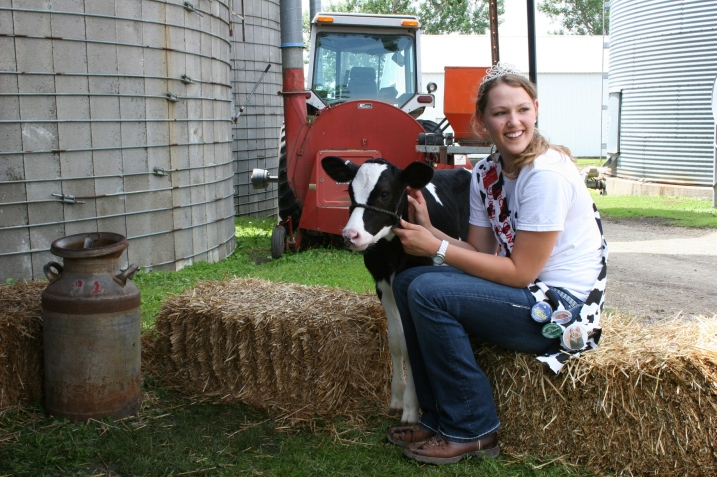 Rice County Dairy Princess Kaylee Wegner waits for kids to arrive for a photo with the calf.