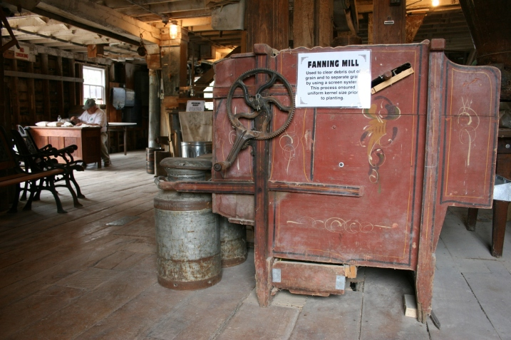 An old fanning mill cleans the grain for planting.