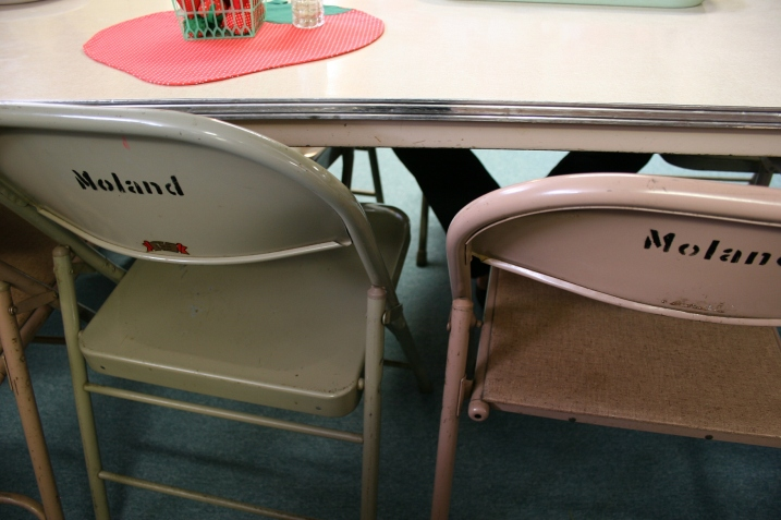 The backs of the folding chairs are labeled with the church name.
