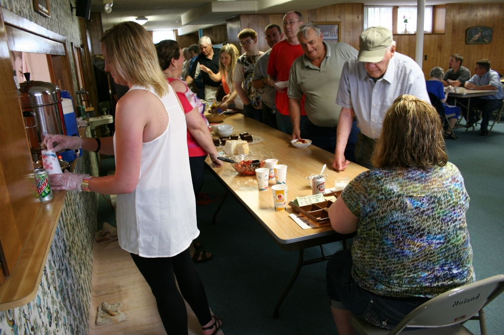Diners file through the food serving line.