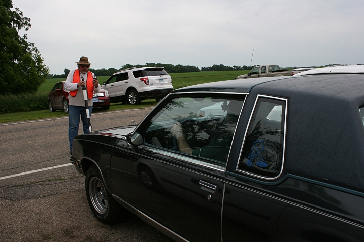 Volunteers guide motorists into parking spaces outside the country church.